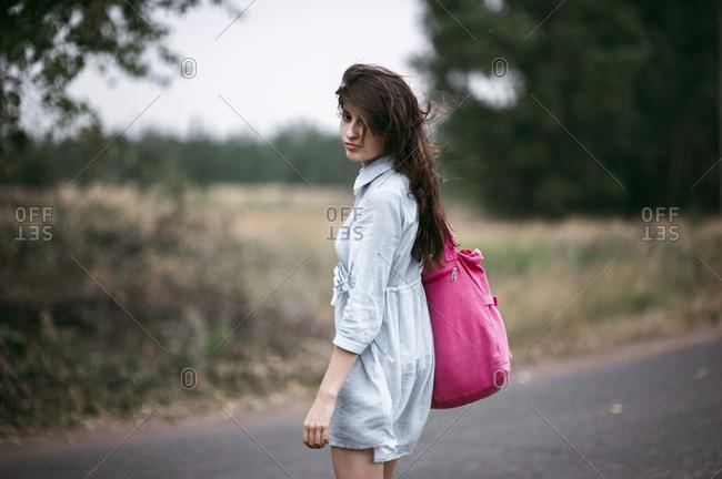 Caucasian woman walking on rural road