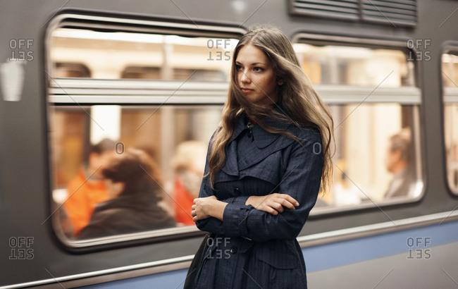 Caucasian woman waiting for subway train