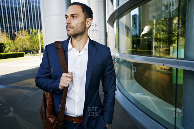Caucasian businessman walking outside office building