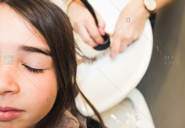 Girl getting hair washed at salon