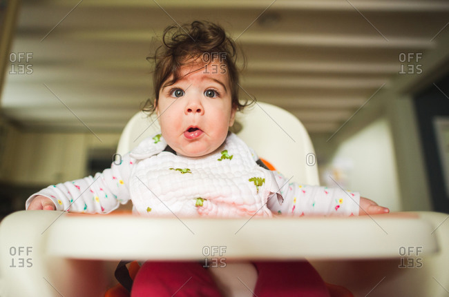Close up of baby in high chair