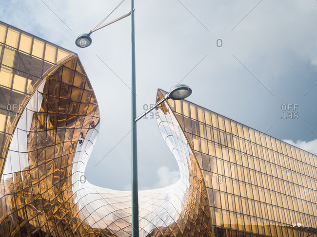 Modern curving building houses a shopping center in Malmo, Sweden