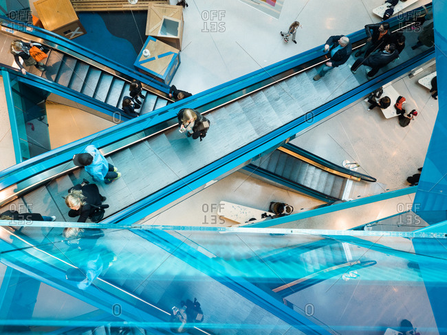 Malmo, Sweden 9/15/2014: Overhead view of people riding escalators in building