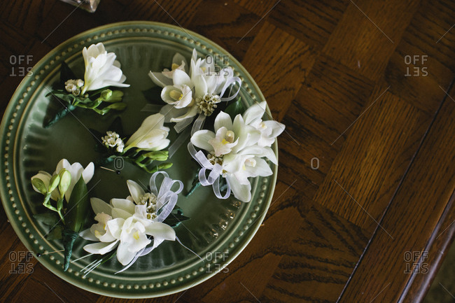 Floral boutonnieres on tray