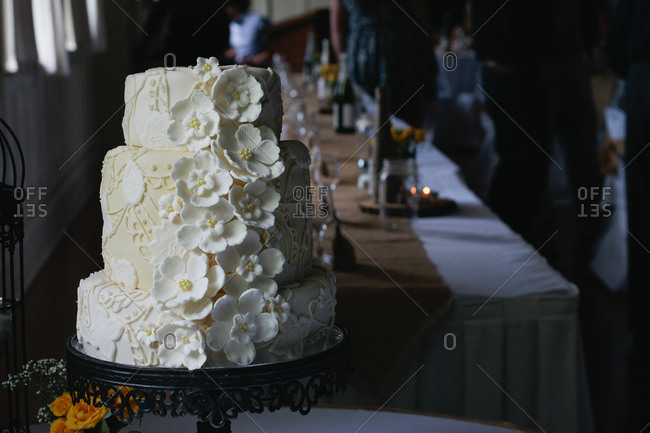 Floral wedding cake on stand