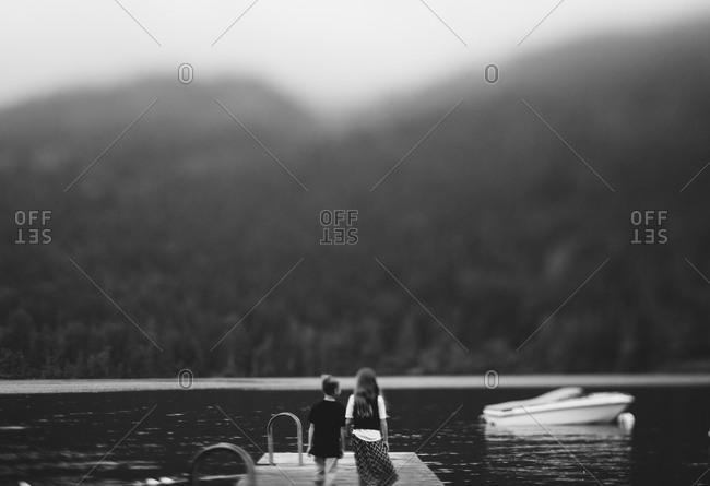 Children on dock of lake