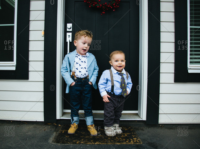 Dressed up boys on porch