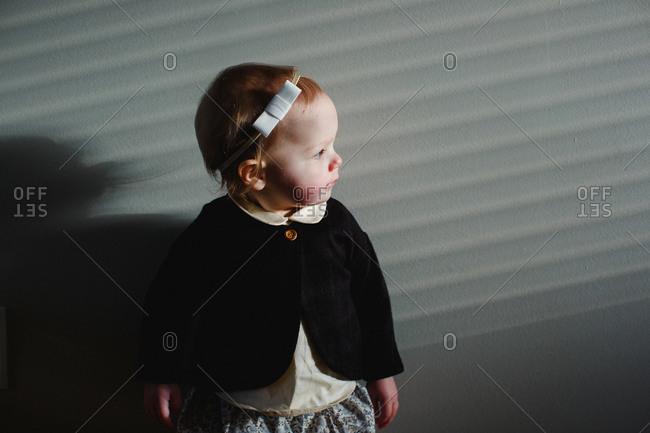 Toddler girl in sunlight