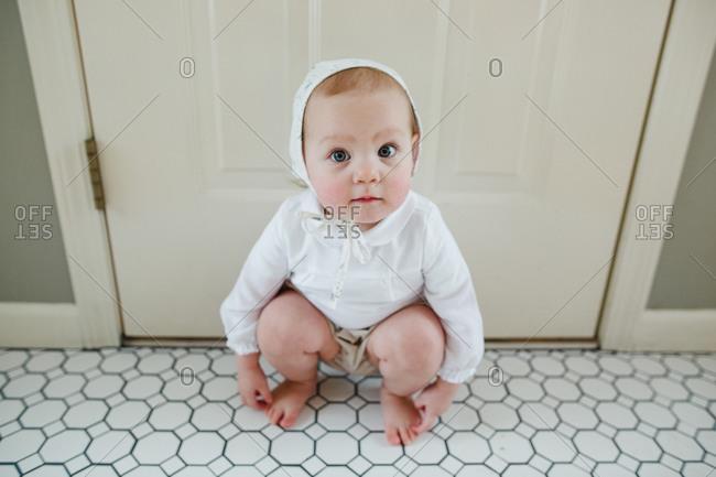 Blue eyed toddler in bonnet