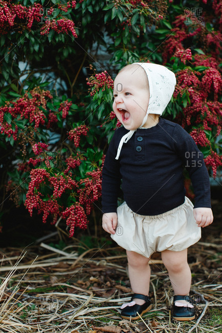 Excited toddler standing outside
