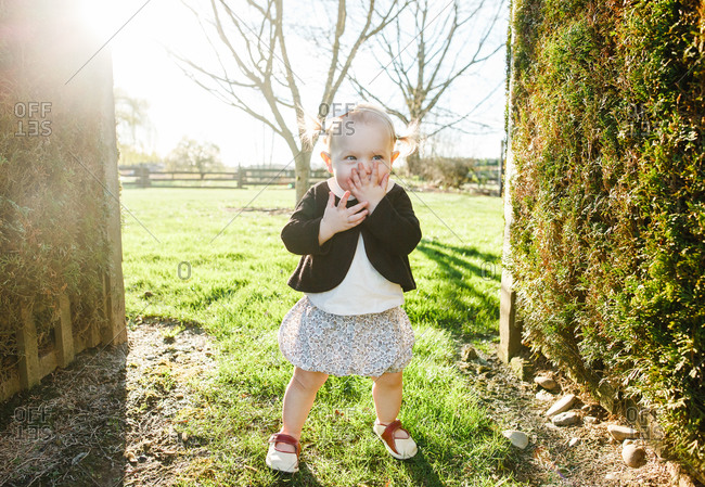 Giggling toddler standing in dress