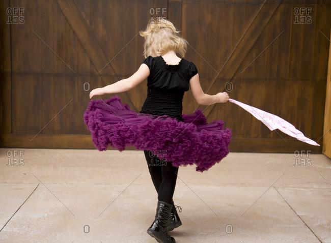 Girl in tutu holding cloth