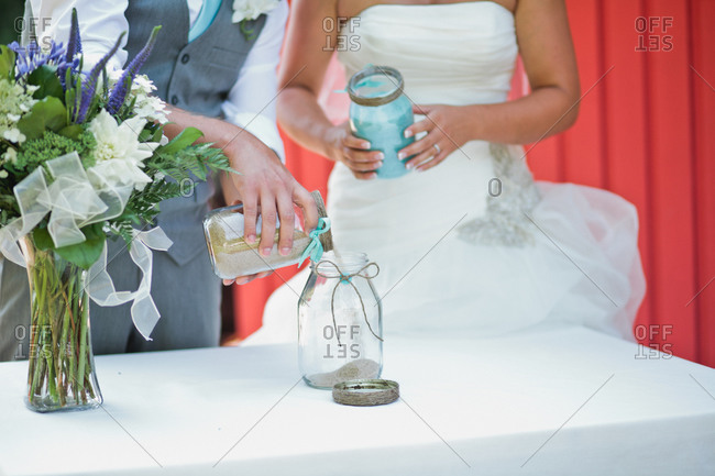 Bride and groom with unity jars