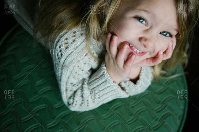 Girl on ottoman smiling