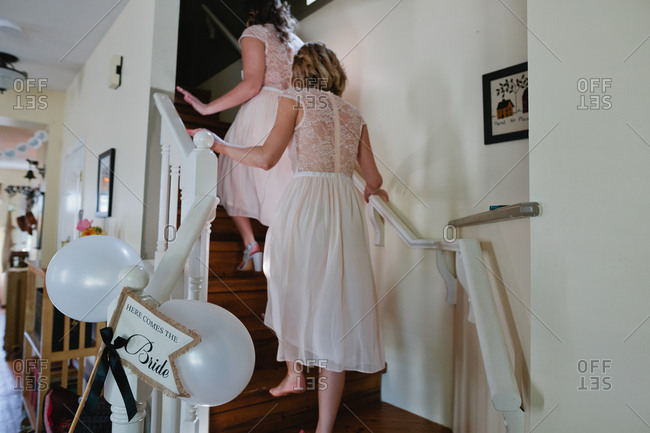 Bridesmaids on steps in house