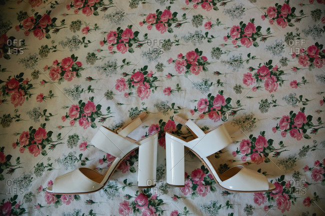 Pair of heels on floral background