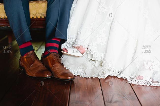 Feet of sitting bridal couple