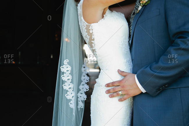 Bride and groom holding each other