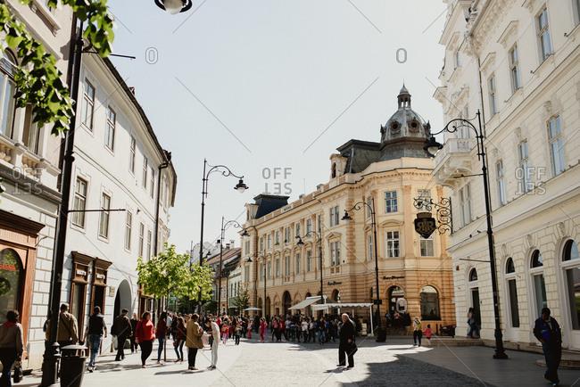 Sibiu, Romania - April 25, 2016: Crowds walking on a historic city street