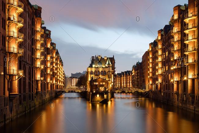Bridges and balconies glowing over the Elbe River in Hamburg
