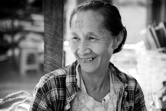 Inle lake, Myanmar - February 1, 2015: Portrait of an older Asian woman smiling