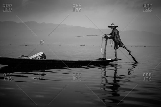 Inle lake, Myanmar - February 2, 2015: Fishermen fishing on Inle lake in Myanmar