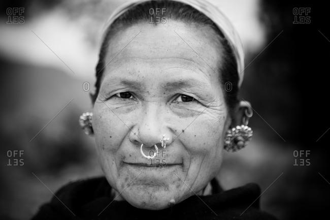 Kathmandu, Nepal - April 18, 2015: Portrait of woman wearing nose rings and earrings