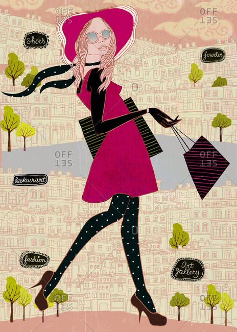Woman walking through town with shops, restaurant and art gallery