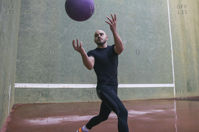 Man throwing a medicine ball