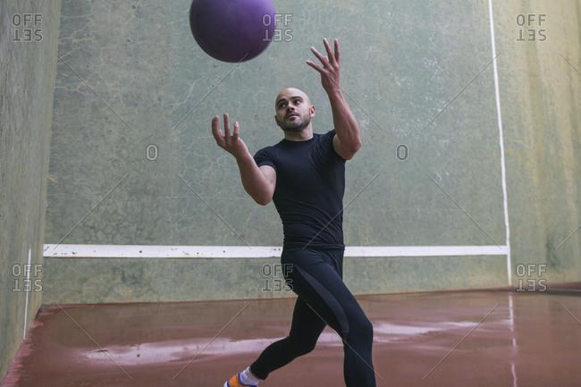 Man throwing a medicine ball