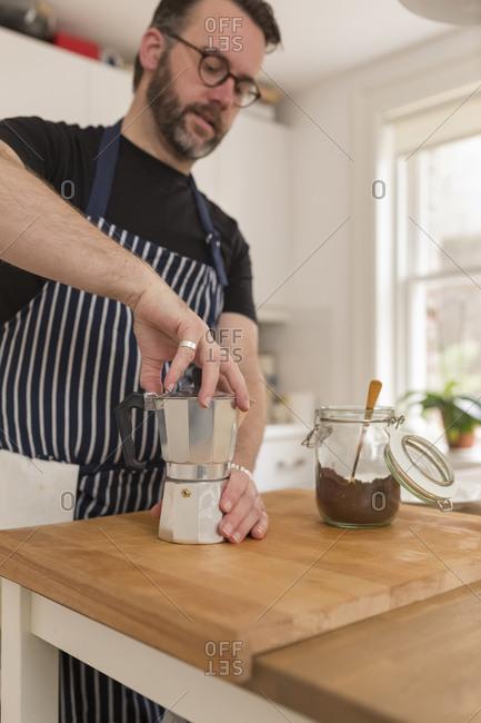 Man preparing espresso in the kitchen