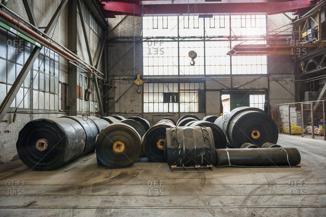 Rolls of rubber in factory hall