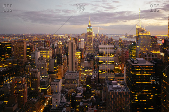 USA, New York City, Manhattan illuminated in the evening, seen from above