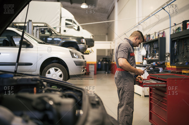 Mechanic repairs and examines the car engine