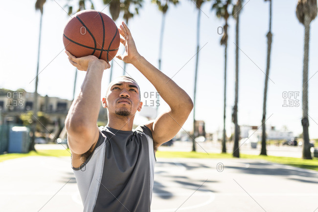 Young man practicing on outdoor court