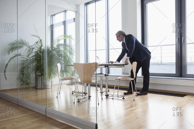 Successful businessman working in board room