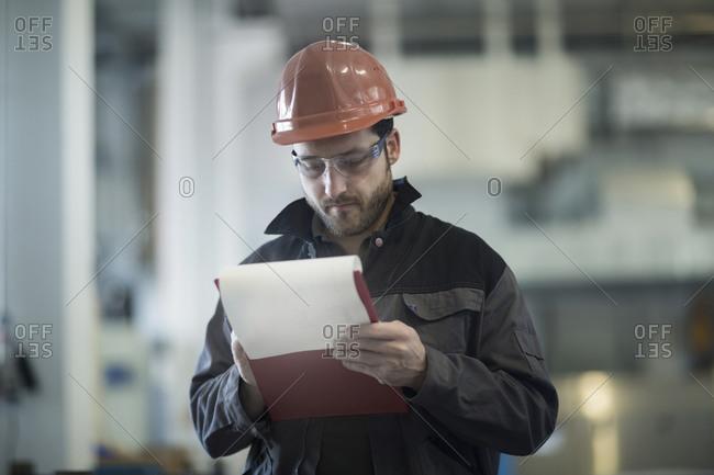 Young technician, working, clipboard
