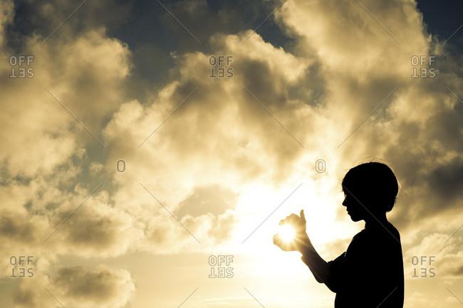 Boy catching the sun - Offset