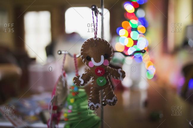 Gingerbread man decoration hanging on a metal hanger
