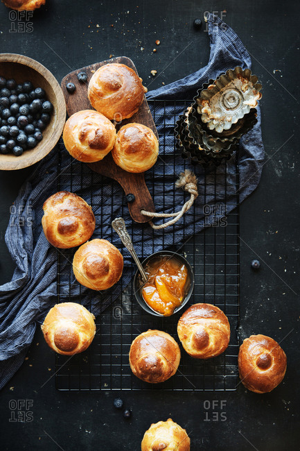 Brioche rolls and pastry tins on a wire cooling rack