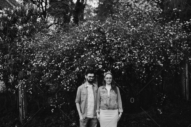 Couple standing under a tree in black and white