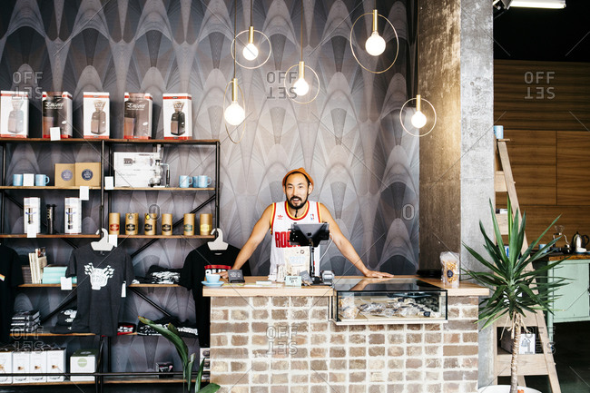 Melbourne, Australia - March 9, 2015: Man standing behind the counter at Aunty Pegs coffee shop