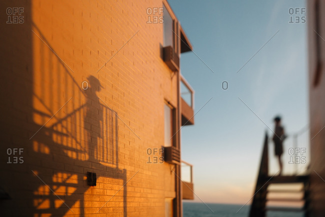 Girl's shadow on coastal building