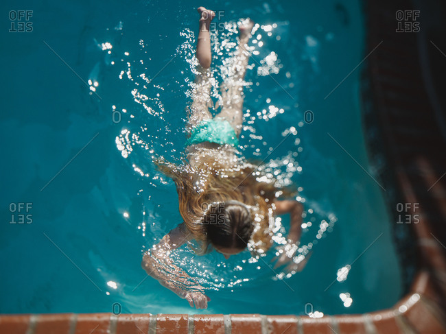 Girl floating in a swimming pool