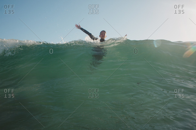 Boy at top of a wave