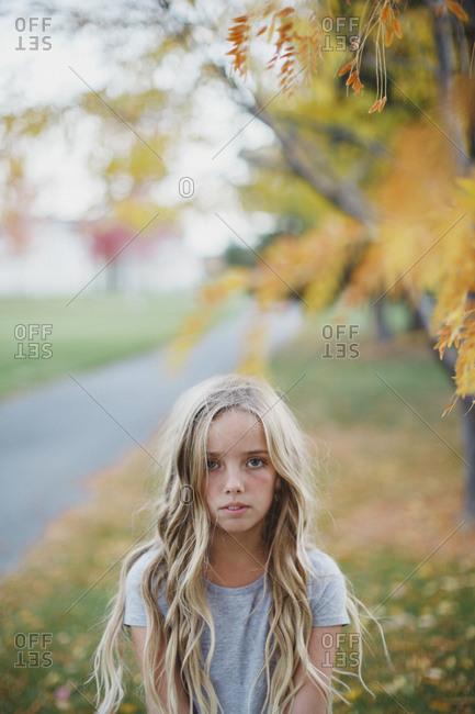 Blonde girl in autumn setting