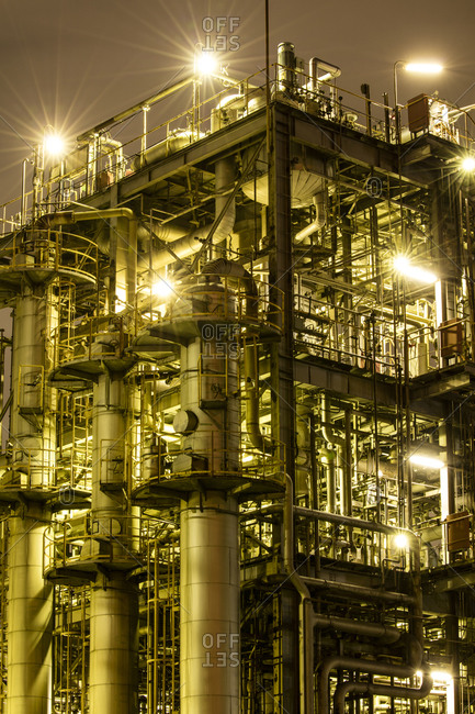 Lights shining at night in an industrial refinery in Japan