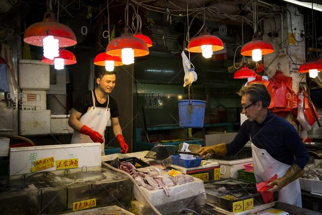 Hong Kong, China - September 16, 2015: Fishmongers working at Bowrington Road Market, Hong Kong