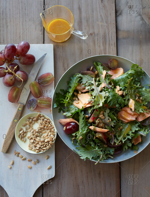 Salmon salad with grapes and sunflower seeds