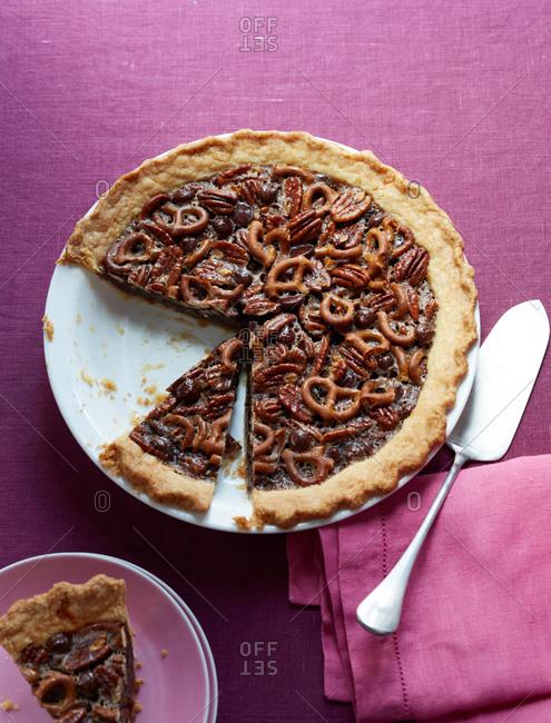 Chocolate pretzel pecan pie sliced and served